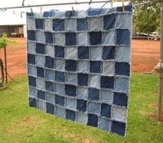 I'd like to do this denim rag quilt for Jason to replace the well worn quilt he uses when he watches TV. It's made from old jeans, alternating light and dark in checkerboard fashion.