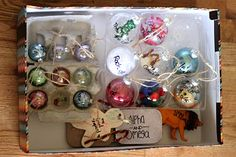 {So doing this next year!} They made 25 different Christmas ornaments, each with a different name of Jesus.  Each day you hang a new one and read the Scripture that goes with that name.  Love, love, LOVE!!