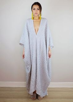 A relaxed, one size linen kaftan with deep v neckline and drop sleeves. cotton& linen * Wash cold or dry clean * Maternity friendly * Available in one size. Fits most (sizes * Length: (Can be made shorter upon request. Hijab Fashion, Fashion Dresses, Punk Fashion, Lolita Fashion, Beach Kaftan, Looks Chic, Caftan Dress, Striped Linen, Striped Maxi