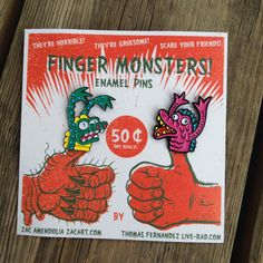 Finger puppet monsters, enamel lapel pins.