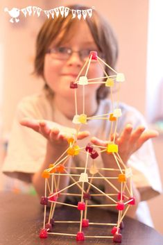 STEM FUN - Build it high, build it low, and pop a few in your mouth as you go! Serious 3D construction fun for kids!
