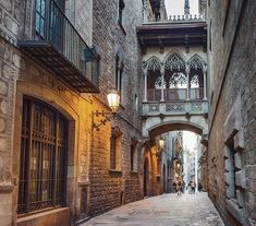 """""""The most gothic town, #Barcelona's Gothic Quarter has a legendary atmosphere with its narrow streets and gothic buildings. We spent at least half a day in this historic neighborhood."""" #Spain  #RouteWhisperer 📍Pont del Bisbe"""