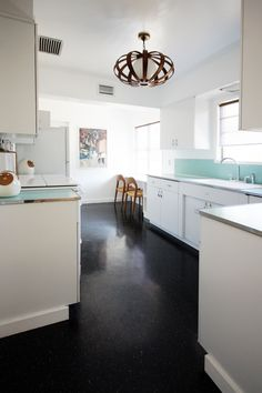 Modern, Simple, Scandinavian elements kitchen | The Brick House ... {that light feature!}