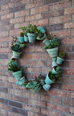 By the Way: Clay Pot Wreath + Succulents = Smile! By the Way: Clay Pot Wreath + Succulents = Smile! Succulent Soil, Succulent Wreath, Cacti And Succulents, Wreath Crafts, Diy Wreath, Mesh Wreaths, Garden Crafts, Garden Projects, Wire Wreath Forms