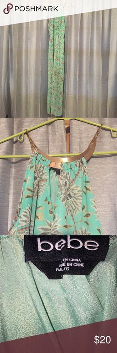 Floral Print Mint Dress Long floral print dress with gold rings to dress up the top! Mint slip underneath and shear from the knee down with a slit on each side to the knee. bebe Dresses Maxi