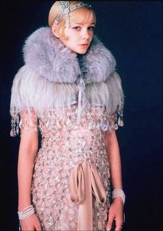 The Great Gatsby (2013) | Carey Mulligan (Daisy Buchanan) wearing a costume from the movie: Jewelry inspired by Tiffany & Co.; Gown and cape inspired by Miuccia Prada with Catherine Martin.