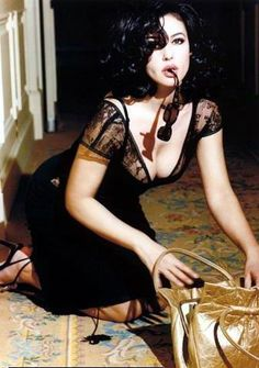 "Monica Bellucci - I love this posed ""candid"" shot."