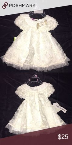 Baby dess. White  dress with floreral print. Nannette Dresses Formal