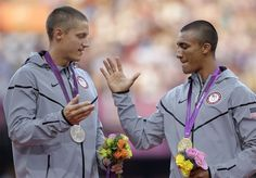 United States' Ashton Eaton, right, gold medalist in the decathlon, shakes hand with silver medalist and compatriot Trey Hardee during the athletics in the Olympic Stadium at the 2012 Summer Olympics, London, Friday, Aug. 10, 2012. (AP Photo/Matt Slocum)