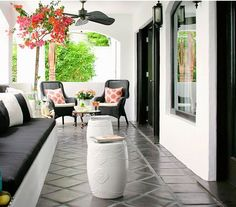 Could paint the terrace tiles balck. Would look HOT with white butterfly chairs!