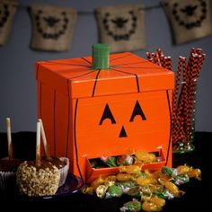 DIY Jack-o-Lantern Candy Dispenser  Cover and decorate a box with Duck Tape