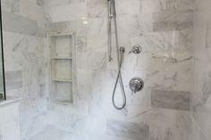 custom shower bench and shower niche, 2 shelves in shower, hidden shower drain, trench drain in shower, white marble hex tiles, white marble tile