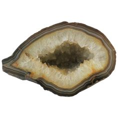 A beautiful and substantial white and brown agate geode natural specimen sculpture piece. Piece makes a great standalone decorative object. Piece measures: H x D x W