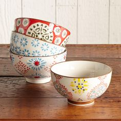 "BOHEME BOWLS -- It's said that variety is the spice of life—celebrate that thought with a ceramic bowls set in a mismatched medley of pattern and color. Dishwasher and microwave safe. Imported. Set of 4. 4-1/4"" dia."