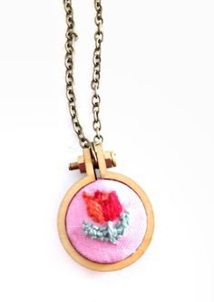 Floral Embroidery Necklace Tulip Cross Stitch Embroidery #BohemianSummerTales #flowercharmnecklace #tulipnecklace #handembroideredjewelry #flowerhoopnecklace #embroideryhoopnecklace