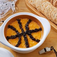 The Garlic & Brie Baker is a party host's MVP. This fun dip is sure to score big with sports fans.  Follow steps 1-4 of 3-Minute-Dip. Remove from microwave; stir. Sprinkle with 2 oz coarsely grated sharp cheddar cheese. Take 1 can (2.25 oz) of diced, drained black olives (about ½ cup) and arrange to make the seams of a basketball. Serve with fresh vegetables or crackers.  For all your Pampered Chef needs go to www.pamperedchef.biz/bowmankitchen