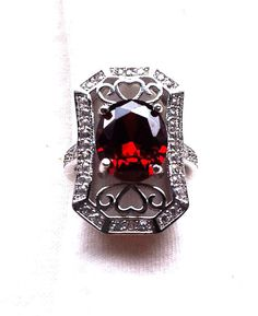 Sterling Silver 925 Ruby Red Stone Tall Statement Cocktail Oval Cut Ring with Heart Detailing and Scrollwork, size Small/Medium 7 O