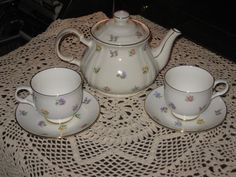 Being offered is one (1) Tea Pot with Lid & two (2) matching Teacups and Saucers.  Made by Sadler China of England.  Fine Bone China.  Pretty