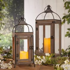 Add that special touch of class and ambiance to your own personal decorative style with this classically-designed 17.7-inch high wood and metal lantern. This beautifully-constructed piece is rectangularly-shaped with a lovely stained wood body and door with bronzed metal hinges and clasp, and has a powder coated metal edges and wires that extend to its 4 balled feet. This charming lantern has a sturdy ring for hanging and will cast its warm white glow year-round.