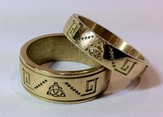 matching 18ct gold wedding rings with mexican motifs