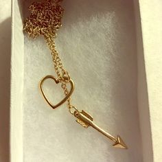 Modcloth Cupid's Arrow necklace in gold Small, dainty, chain - easy to match - enclosure is the arrow through the heart ❤️ Very cute! ModCloth Jewelry Necklaces