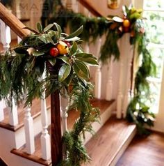 christmas garland with clementines and magnolia leaves