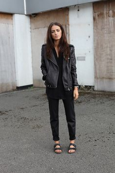 All black outfit: leather jacket and Birkenstock sandals.