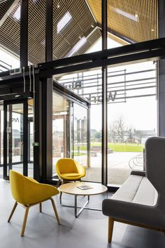 naughtone Canary Yellow Always Chairs with trace table and Hush Sofa. Gorgeous atrium interior.