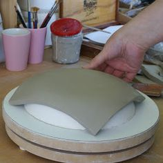 ArtMind How to make and use a positive mould. My inspiration Use a half deflated ball instead and make coil stand on bottom of plate. & Dropped slab of clay on a frame - creates really cool plates and ...