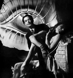 Salvador Dalí with Mad Isolde (Tony Hollingsworth) in front of his painted backdrop for a ballet. Photo by Philippe Halsman, 1945