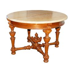 Large Victorian rosewood marble top center table with detailed legs and finial. This is an exceptional quality piece with a lovely sienna colored top.