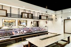 Mercato e Cucina is a 1200sqm Italian's dream with a butcher, deli, grocer, bakery, wine cellar and restaurant. Mima Design were asked to develop a bare shell new-build environment on busy Victoria Road, Gladesville into an Italian provider.