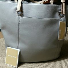 NWT- MICHAEL KORS Grey Leather Tote MICHAEL KORS Pearl Grey Leather Tote Magnetic snap top BRAND NEW, NEVER USED with original tags NO FLAWS WHATSOEVER  I work in L.A as a wardrobe stylist for film and television. All my items are authentic and come from high end boutiques or stores. Michael Kors Bags