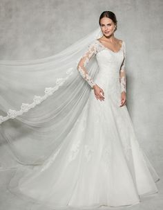 The sensational 'Catherine' by Anna Sorrano  We love this lace embroidered long sleeved gown  Could this be your dream wedding dress? www.wed2b.co.uk