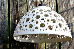 Ceramic light chandelier with holes of different sizes in beautiful white color. Comes with chain. It is suitable for interior and also exterior.