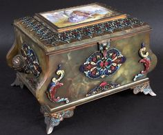 A SUPERB 19TH CENTURY FRENCH ONYX AND CHAMPLEVE ENAMEL JEWELLERY CASKET, the lid inset with a porcelain plaque depicting young lovers, the interior with a mirror and silk lined