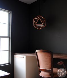 This DIY geometric copper light fixture will make a huge statement in your space, but is simple to make with this detailed tutorial!