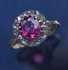 VICTORIAN  Ring   Gold Ruby Diamond  H: 1.2 cm (0.47 in)   British, c.1880  Ring Case  14 rose cut diamonds 0.50 cts approx   7.7 mm x 6.5 mm oval ruby 1.25cts approx  Suitable as an engagement ring  Ref: 7156