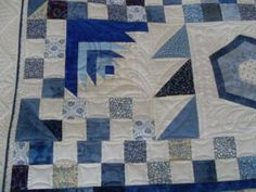 Blue and White quilt pieced by Studio Quilters and quilted by Englishquilter