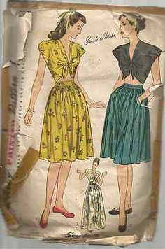 WWII era summer skirt set. Cute tie front top with cap sleeves and bare midriff and a gathered straight skirt.