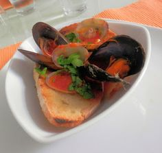 Shellfish Soup with mussels and clams in a tomato broth over grilled bread.