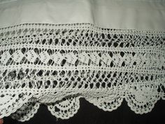 Pillowcase with hand crochet lace edging.  Beautiful bed and table linens are among the offerings at The Gatherings Antique Vintage.  Many pieces are from trousseau from the late Victorian or early 1900's.
