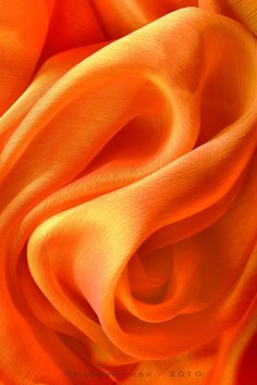 vivid orange fabric folds - use for inspiration on how to highlight and color fabric