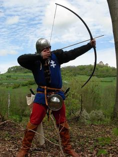 15th century archer, bit richly clad methinks. that dark blue fabric would have been expensive.