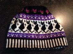 Knitted hat with cats I made, pattern by Sandra Jager.