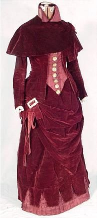 c. 1881 Burgundy Velvet and Satin 4-piece Autumn Ensemble - color and fabrics aren't my jam but I like the giant buckle and the contrast between cape jacket & bodice.