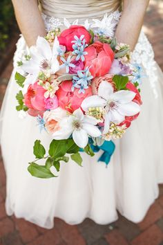 Beautiful wedding bouquet - love the touches of blue!