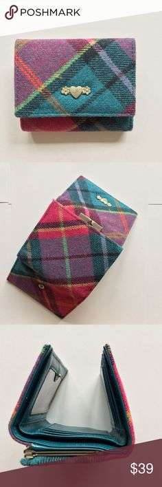 "NWT Ness Scotland Tweed Trifold Tartan Plaid Wool RETIRED STYLE  If you ask us, finance is not fun enough! Which is why we've added our signature quirky style to your favorite tweed wallet. This wallet is a luscious wool tartan in CRUSH with a complementary blue/teal lining. It will brighten your mood every time you open it.   - 70% Wool, 30% Nylon - Gold tone logo - 6 Credit card slots - See through ID - Outer coin purse - Trifold with snap closure - Closed: 4.5"" (L) x 3.75"" (H) x 1.25"" (D)…"