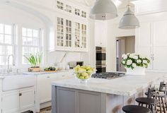 Classic kitchen with marble bench, grey island and shaker cabinets by Nancy Serafini Interior Design.