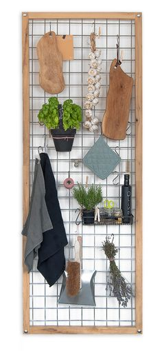 Kitchen solution: hang tools, pans, herbs. I like the industrial look of it.